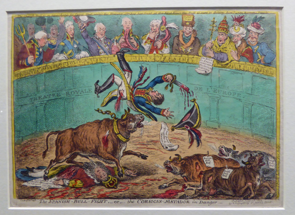 The Spanish Bull Fight or The Corsican Matador in Danger, by James Gillray, first published by Hannah Humphrey 11 July 1808. In the caricature, Napoleon is tossed because he failed to strike the Spanish bull dead with his first stroke; his brother Joseph, recently crowned king, is trampled underfoot. The Spanish uprisings seemed to show Europe (its representatives pictured in the stands) that it was possible for a country to overthrow a tyrant. Photo taken during exhibit Bonaparte and the British at the British Museum, 2015